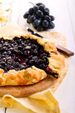 Black grapes and rosemary tart Royalty Free Stock Photo