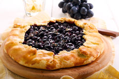 Black grapes and rosemary tart Stock Photos