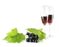 Black grapes and tall wine glasses isolated Royalty Free Stock Photo