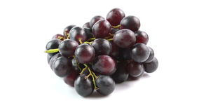 Black grapes on white background stock footage