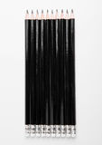 Black graphite pencils with eraser on white Royalty Free Stock Photography
