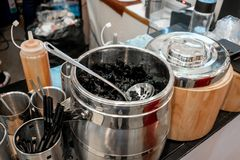 Black grass jelly dessert herbal gelatin with syrup in stainless Stock Photo