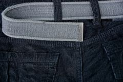 Texture of black cloth trousers and gray belt royalty free stock image