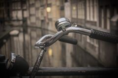 Black and Gray Bicycle Handle Bar With Bell Near Canal Stock Photo