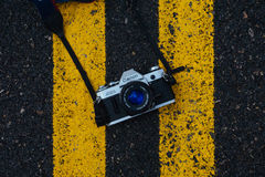 Black and Gray Canon Digital Camera on Black and Yellow Surface Stock Photos