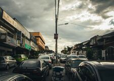 Black and Gray Car Under Cloudy Sky Royalty Free Stock Image