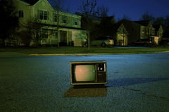 Black and Gray Classic Tv on Black Road Royalty Free Stock Photo