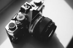 Black and Gray Dslr Camera on White Surface stock image