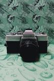 Black and Gray Film Camera on Green Floral Textile Royalty Free Stock Photo