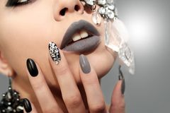 Black gray glam matte makeup and manicure Royalty Free Stock Photography