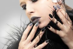 Black gray glam matte makeup and manicure Stock Photo