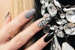Black gray glam matte manicure Stock Images