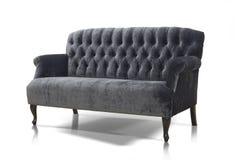 Black-gray Luxurious sofa. Isolated on white background Stock Photography