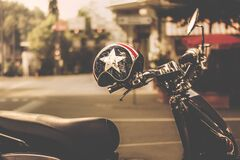 Black and Gray Motor Scooter With Black and White Star Print Half Face Helmet stock images