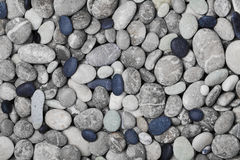 Black and gray pebbles for background for spa, natural macro texture Stock Photos