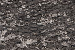 Black gray plastic mesh texture on the ground. Black gray plastic mesh background on the ground royalty free stock photography