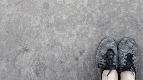 Black and gray urban sneakers background stock photos