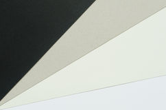 Black, gray and white construction paper sheets Stock Photography