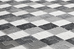 Black gray and white pattern of roadside pavement Royalty Free Stock Photo