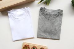 Black , gray , white t-shirts with wood box and cactus. rustic background stock image