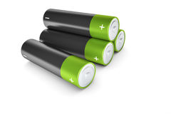 Black and green batteries Stock Photos