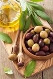 Black and green marinated olives oil sage leaf Stock Image