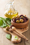 Black and green marinated olives oil sage leaf Royalty Free Stock Photography