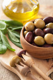 Black and green marinated olives oil sage leaf Stock Photography