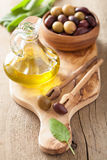 Black and green marinated olives oil sage leaf Royalty Free Stock Photos