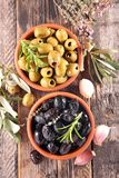 Black and green olive and herbs Stock Images