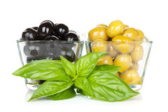 Black and green olives with basil Royalty Free Stock Photo