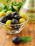 Black and green olives and a bottle of olive oil stock photography