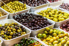 Black and green olives on display Royalty Free Stock Image