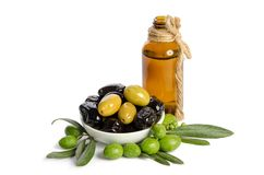 Black and green olives mixed in the porcelain bowl and Virgin olive oil. Black and green  olives  mixed in the  porcelain bowl and Virgin olive oil in a crystal Royalty Free Stock Photography