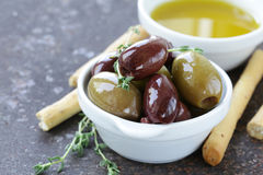 Black and green olives in oil Royalty Free Stock Photo