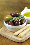 Black and green olives in oil Royalty Free Stock Images