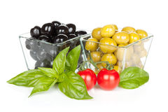 Black and green olives and tomatoes with basil Royalty Free Stock Photography