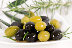 Black and green olives. On a white background stock photo