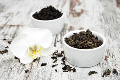 Black and green tea with orchid flower Royalty Free Stock Images