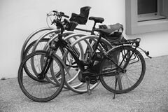 Black and Grey Bicycle Park Beside Wall Royalty Free Stock Images