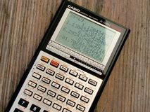 Black and Grey Casio Scientific Calculator Showing Formula Royalty Free Stock Image