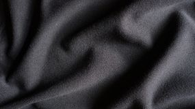 Cotton Fabric Texture Woven Cloth Background Close Up. Black & grey cotton fabric texture woven cloth background with slight wave effect Stock Images