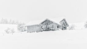 Black and Grey House Covered by the Snow Royalty Free Stock Photography