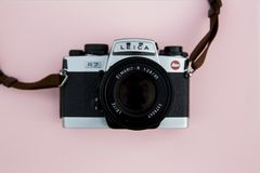 Black and Grey Leica Camera on Pink Background royalty free stock images