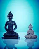 Black and grey stone buddahs Royalty Free Stock Photography