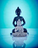 Black and grey stone buddahs Stock Images