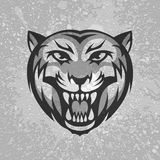 Black and grey tiger head logo on dirty plaster Stock Photo