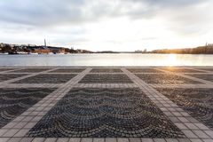 Black Grey Tiles Near River during Sunset Stock Images