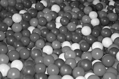 Black grey white balls for dry massage. Black-and-white photo.  royalty free stock photo