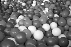 Black grey white balls for dry massage. Black-and-white photo.  royalty free stock images
